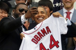 "U.S. President Barack Obama poses with player David Ortiz for a ""selfie"" as he welcomes the 2013 World Series Champion Boston Red Sox to the South Lawn of the White House in Washington"