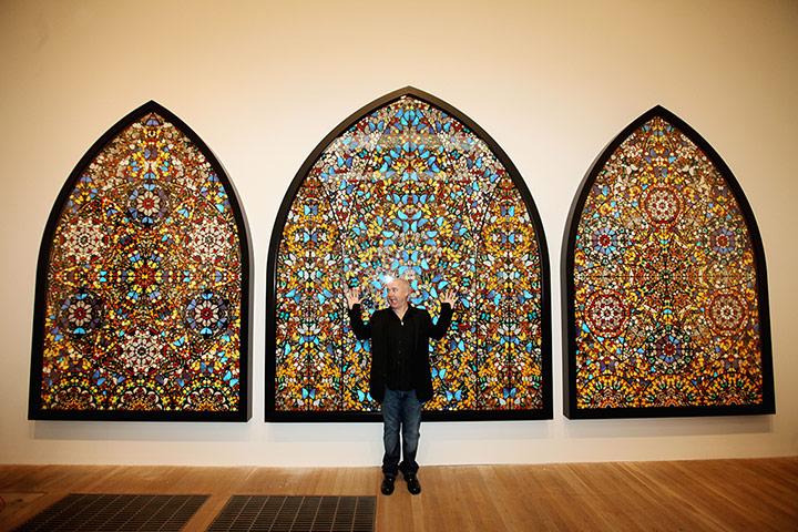 Damien Hirst poses infront of 'Doorways to the Kingdom of Heaven', photo by Graeme Robertson for the Guardian